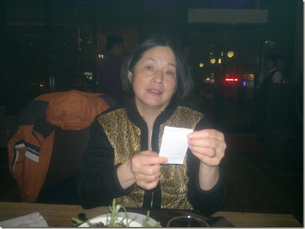 Mei checking every detail of the bill for our meal